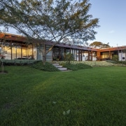 This large lawn is the perfect place for architecture, cottage, estate, facade, grass, home, house, land lot, landscape, property, real estate, residential area, yard, green