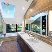 A substantial skylight lights this master bathroom suite daylighting, estate, home, house, interior design, property, real estate, window, white