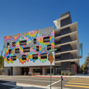 :The new Washington Arts Building combines carparking with apartment, architecture, building, commercial building, condominium, corporate headquarters, daytime, facade, hotel, metropolitan area, mixed use, neighbourhood, real estate, residential area, sky, blue