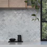 A unique, scaled splashback floor, flooring, interior design, tile, wall, gray, black