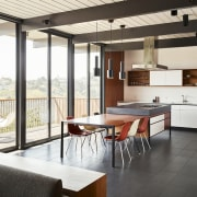 The kitchen is open and spacious architecture, house, interior design, loft, real estate, table, window, white