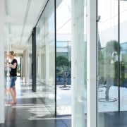 A courtyard inside the office is a source door, floor, glass, window, white
