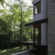 The home is completely private architecture, cottage, home, house, real estate, siding, tree, black