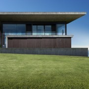 A view of the home from the lawn architecture, building, corporate headquarters, elevation, estate, facade, grass, home, house, lawn, property, real estate, residential area, sky, villa