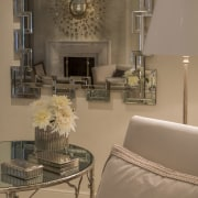 The fireplace through the mirror ceiling, floor, furniture, home, interior design, living room, room, table, wall, brown