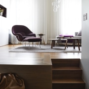 The stairway leading up to the living area floor, flooring, furniture, hardwood, interior design, laminate flooring, living room, product design, table, wood, wood flooring, white, black