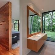 The floating vanity makes this bathroom feel substantially architecture, estate, floor, flooring, hardwood, home, house, interior design, real estate, room, window, wood, wood flooring, gray