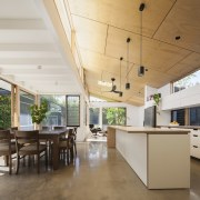 The home has a clear relationship with the architecture, ceiling, daylighting, floor, house, interior design, real estate, roof, table, white, brown
