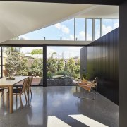 A large, polished floor reflects the sky architecture, ceiling, daylighting, floor, house, interior design, living room, real estate, window, gray, black