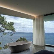 Bathroom views don't get much better than this architecture, ceiling, condominium, daylighting, home, house, interior design, property, real estate, window, gray, black