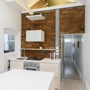 Keeping the stove and sink in one space architecture, cabinetry, ceiling, countertop, daylighting, floor, flooring, house, interior design, kitchen, loft, real estate, room, wood flooring, white