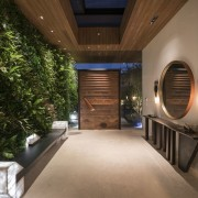 The green wall creates a dramatic entranceway architecture, ceiling, estate, home, house, interior design, lighting, property, real estate, brown