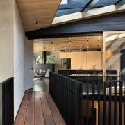 Designed by Strachan Group Architects, this home's open-plan architecture, daylighting, house, interior design, lobby, real estate, roof, wood, black, brown