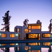 It's a home that's fit for place architecture, estate, home, house, lighting, mixed use, property, real estate, reflection, residential area, sky, villa, blue