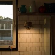 White tiles create a diner-like splashback house, light, light fixture, lighting, wall, window, wood, brown