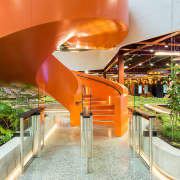 The curling steel staircase provides a vibrant, eye-catching architecture, orange, white