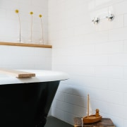 A black claw foot tub draws the eye bathroom, ceramic, floor, flooring, interior design, plumbing fixture, product design, room, sink, tap, tile, wall, white