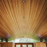 The roof certainly echoes the surrounding canyon hills architecture, beam, ceiling, daylighting, home, interior design, light, lighting, property, wall, wood, wood stain, brown, orange