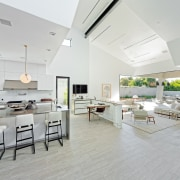 The kitchen flows out through the lounge and ceiling, floor, flooring, house, interior design, living room, real estate, gray