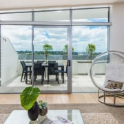 Find out more about 585 Rothesay Bay balcony, door, home, house, interior design, living room, property, real estate, window, gray
