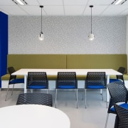 A central blue pillar and chairs reflect the ceiling, classroom, conference hall, interior design, office, product design, table, white