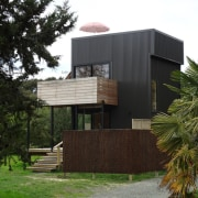 Graham Phipps-Black – Ruby Bay, Nelson house architecture, cottage, facade, home, house, property, real estate, tree, black, brown