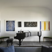 Art surrounds the piano architecture, ceiling, furniture, interior design, living room, room, table, wall, window, gray