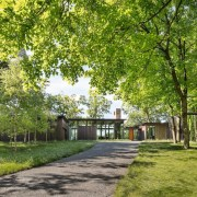 The home is completely immersed in the forest cottage, estate, farmhouse, grass, home, house, land lot, landscape, nature reserve, park, plant, plantation, property, real estate, tree, yard, brown
