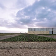 There's plenty of room outside the main building architecture, cloud, farm, field, grass, home, horizon, house, land lot, landscape, real estate, rural area, sky, teal, gray