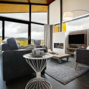 Inside the villa during one of the warmer furniture, interior design, living room, real estate, table, black, gray