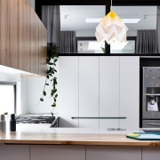 The light is certainly the star of the countertop, furniture, home, interior design, kitchen, product design, room, white, gray