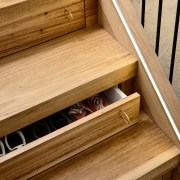 Drawers in the stairs take advantage of previously-unused drawer, floor, flooring, furniture, hardwood, lumber, plywood, product, product design, wood, wood stain, brown, orange