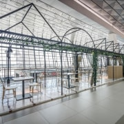 Subtle green touches create a greenhouse-like aesthetic inside daylighting, structure, gray, white