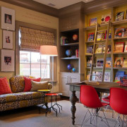 The children's library features high shelves and large bookcase, ceiling, furniture, home, interior design, living room, lobby, real estate, room, shelving, wall, brown, gray