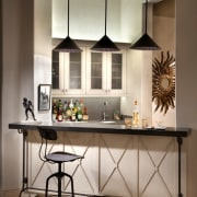 A small bar area sits off to the cabinetry, countertop, cuisine classique, furniture, interior design, kitchen, table, gray, brown