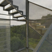 569 firestation architecture, cage, chain link fencing, facade, fence, mesh, gray