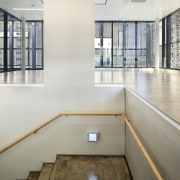 The 925 Building architecture, daylighting, floor, flooring, glass, handrail, interior design, real estate, wall, gray, white