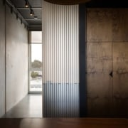 Stained plywood walls add to the industrial feeling architecture, ceiling, daylighting, door, floor, house, interior design, property, wall, window, wood, black