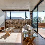 Downplaying the informal lounge area means a greater architecture, daylighting, house, interior design, living room, property, real estate, roof, window, wood, gray