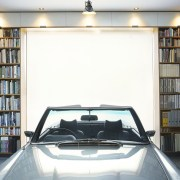 This library/garage has plenty of utility automotive design, automotive exterior, car, family car, motor vehicle, vehicle door, white, gray