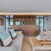 This lounge sits next to the kitchen architecture, house, interior design, living room, real estate, gray