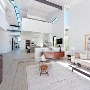 The skylights have been specially designed to track floor, interior design, living room, white