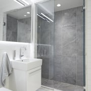 A floating vanity helps to make this bathroom bathroom, bathroom accessory, floor, glass, interior design, plumbing fixture, product design, room, gray, white