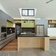 A clerestory window illuminates the olive and grey cabinetry, countertop, interior design, kitchen, living room, real estate, room, gray