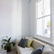 The owner/architect also built the home and handled ceiling, daylighting, floor, home, house, interior design, living room, loft, room, window, gray, white