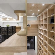 The balustrade separates the two levels cabinetry, ceiling, closet, floor, flooring, furniture, interior design, lobby, room, shelving, brown, gray