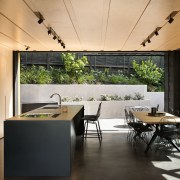 This mid-level kitchen and dining area by Strachan architecture, house, interior design, real estate, roof, table, black