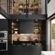 A dedicated cooking space keeps things tidy in countertop, interior design, kitchen, black
