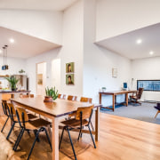 Kitchen, dining and office all share one space ceiling, dining room, floor, flooring, hardwood, interior design, living room, property, real estate, room, table, white