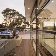 Sandstone featuring on the facade of this hillside apartment, architecture, balcony, condominium, daylighting, handrail, home, house, interior design, penthouse apartment, property, real estate, roof, window, brown